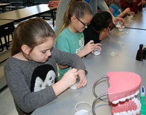 picture of fourth graders mixing up toothpaste