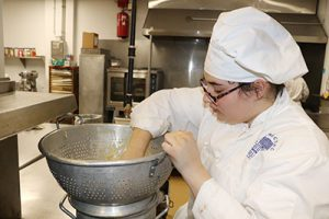 picture of WHS student working in Career and Technical School culinary prep classroom