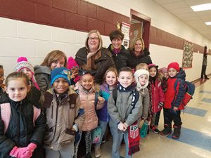 picture of 2019 Friend of Education Brenda Zawitkowski surrounded by elementary students