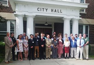 picture of students and Watervliet city officials standing in front of City Hall