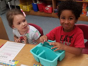 picture of kindergarten students practicing letters