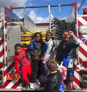 picture of students on back of fire truck
