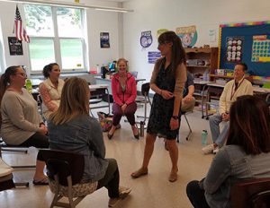 picture of teachers seated in circle engaged in restorative practice activity