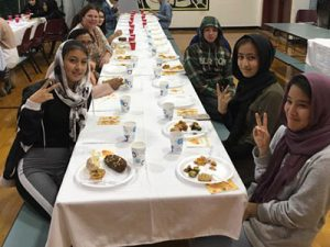 picture of students seated at Thanksgiving table