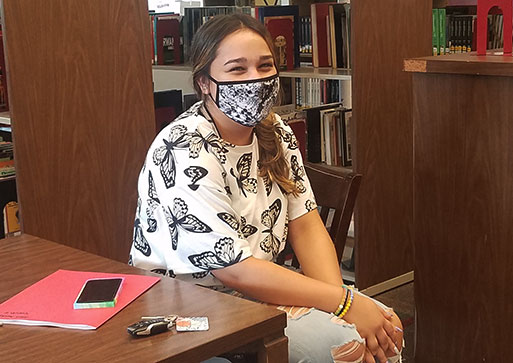 picture of high school student seated at desk wearing face mask