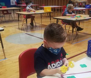 picture of prekindergarten student playing with Lego-type toy